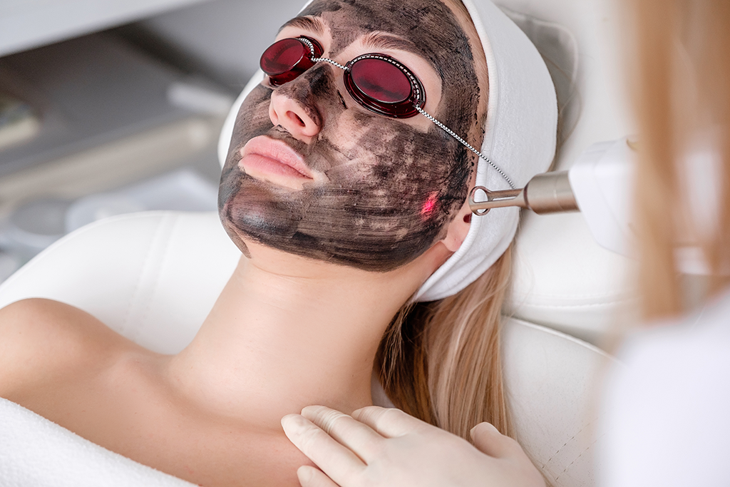 Woman modeling laser hair removal at Laser Partners